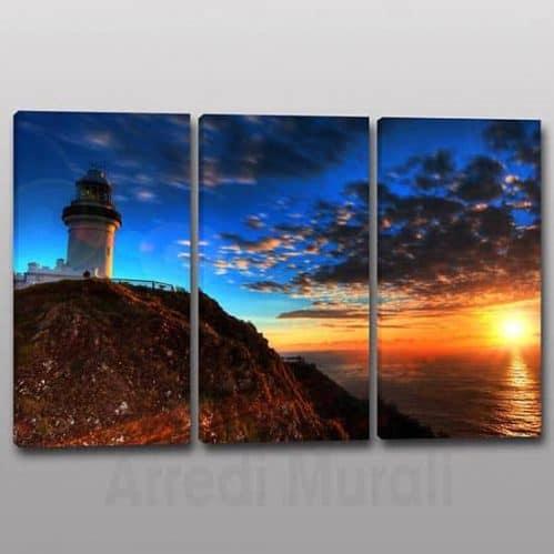Quadri moderni faro 3 tele con tramonto sul mare