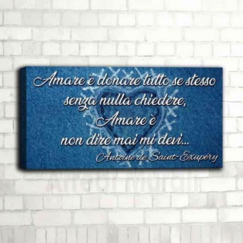 frase su quadro moderno riporta famosa citazione di Antoine de saint exupéry